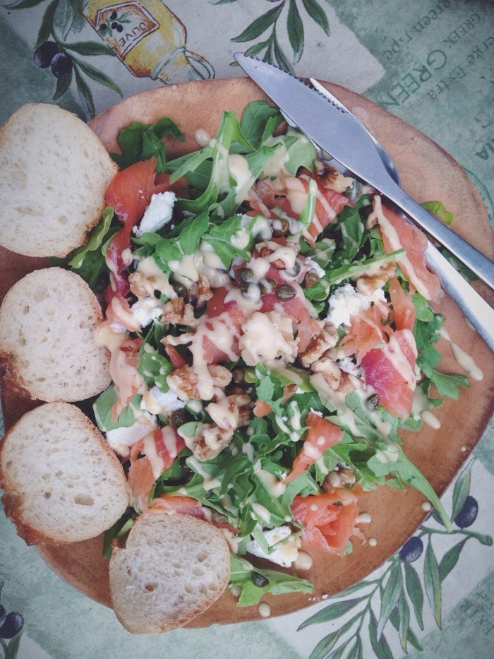 my lunch, a salmon, arugula, caper and toasted walnut salad with lemon dijion vinagrette