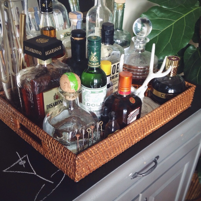 My version of a bar cart, this is a bar station complete with a chalkboard top to feature specialty drinks on fun occassions