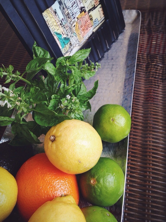 This tray is on the coffee table in our kitchen seating area. I use it to hold my always present supply of citrus but move it to the counter when setting out appetizers for guests