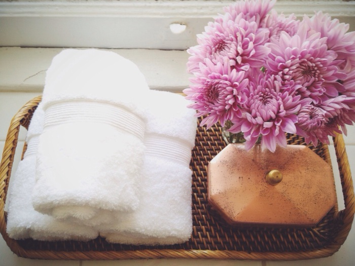 This tray in our bathroom is perfect for a yummy smelling candle and hand towels at the ready