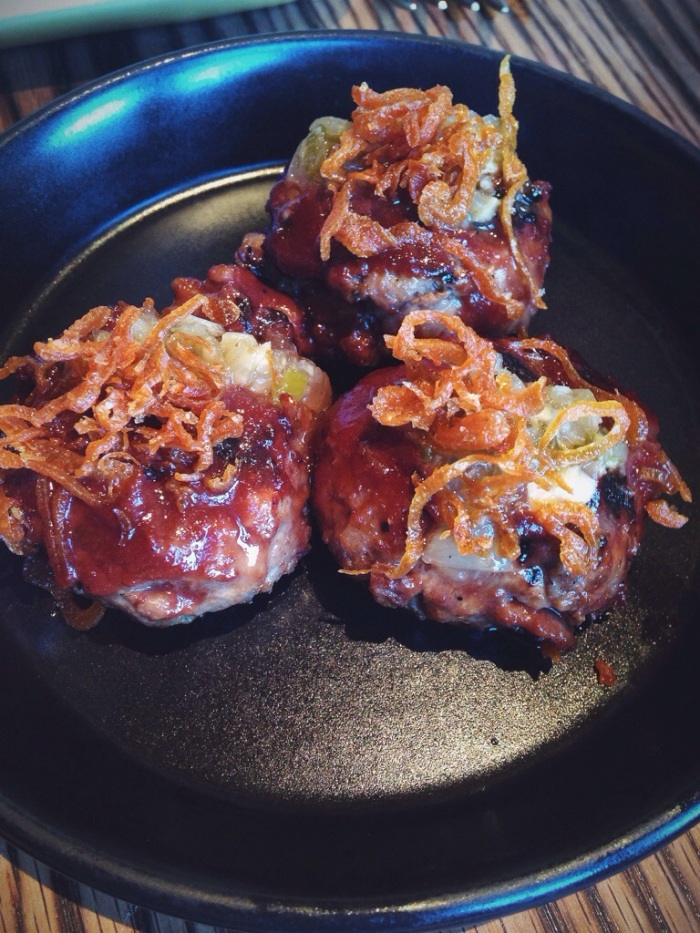Bombdiggitybombbomb. Melt in your mouth meatballs topped with fried shallots.