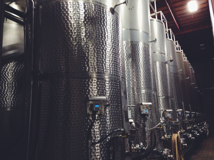 Fermenting tanks in the cellar are wrapped with cooling jackets (the textured bands you see) to help control temperatures and ensure proper fermentation for each style of juice