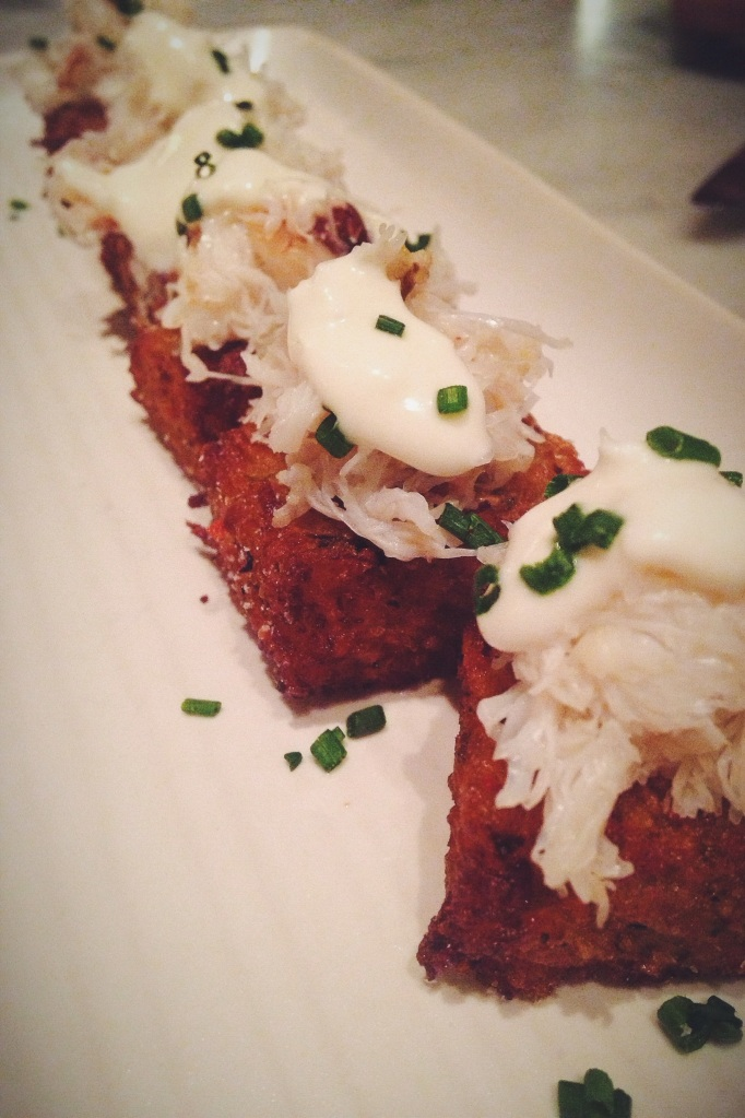 dungeness crab tater tots with creme fraiche and chives