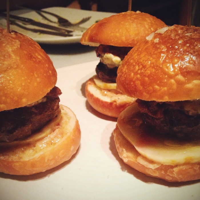beef sliders, with short rib marmalade, blue cheese, bacon aioli and homemade pickles