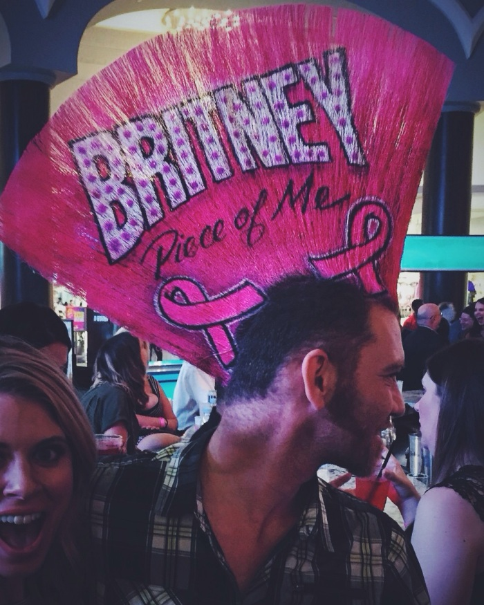 This guy raises money for breast cancer and promotes Britney on his hair. WTF.