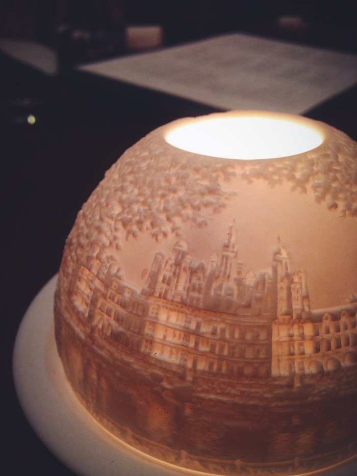 A beautiful votive showcasing the chef's hometown of Saint Hilaire de Loulay in France