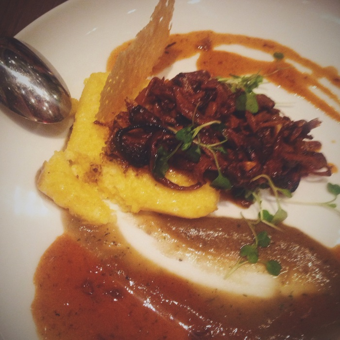 Seared Polenta with wild mushroom, vegetable demi-glace, cheese crisp