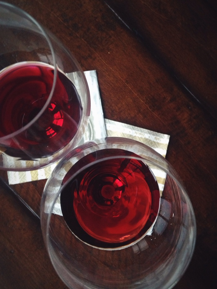 The Beaujolais is the slightly deeper red/purple glass on top