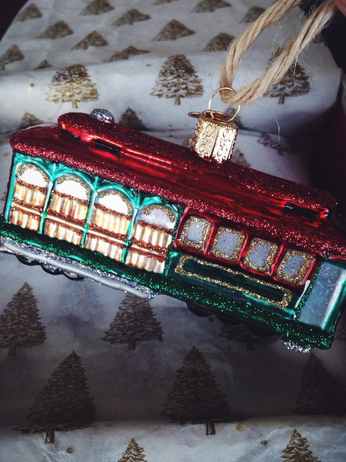 Every Christmas I give my hubby a blown glass ornament with the year written on the bottom, this year was a cable car to represent our first home in San Francisco