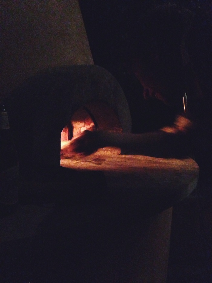 The master at work with the oven. Adding outdoor pizza oven to the list of items in my dream home, for reals!