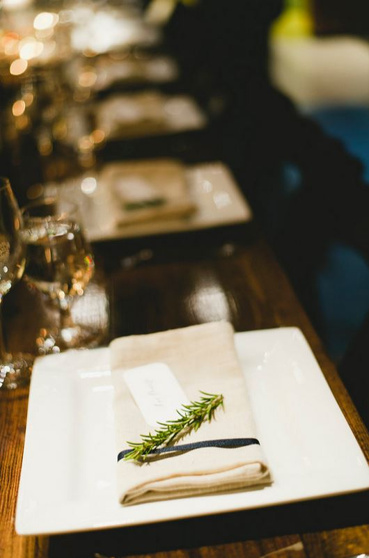 The table setting was simple, and I loved it. A linen napkin and navy ribbon with a sprig of rosemary, a nod to my love of cooking.