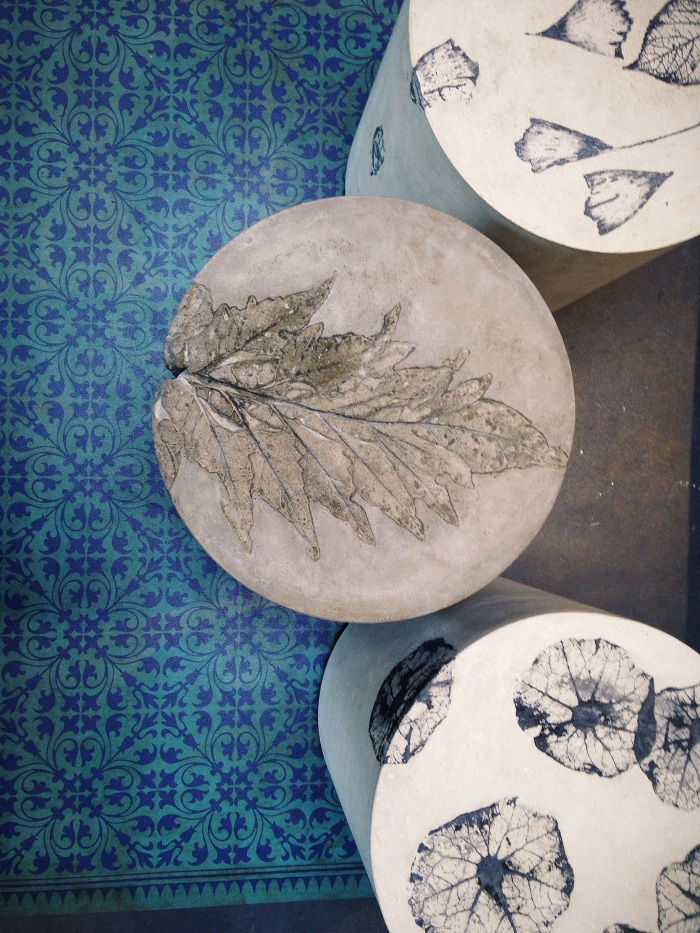 Concrete side tables with fossilized beauties built in.