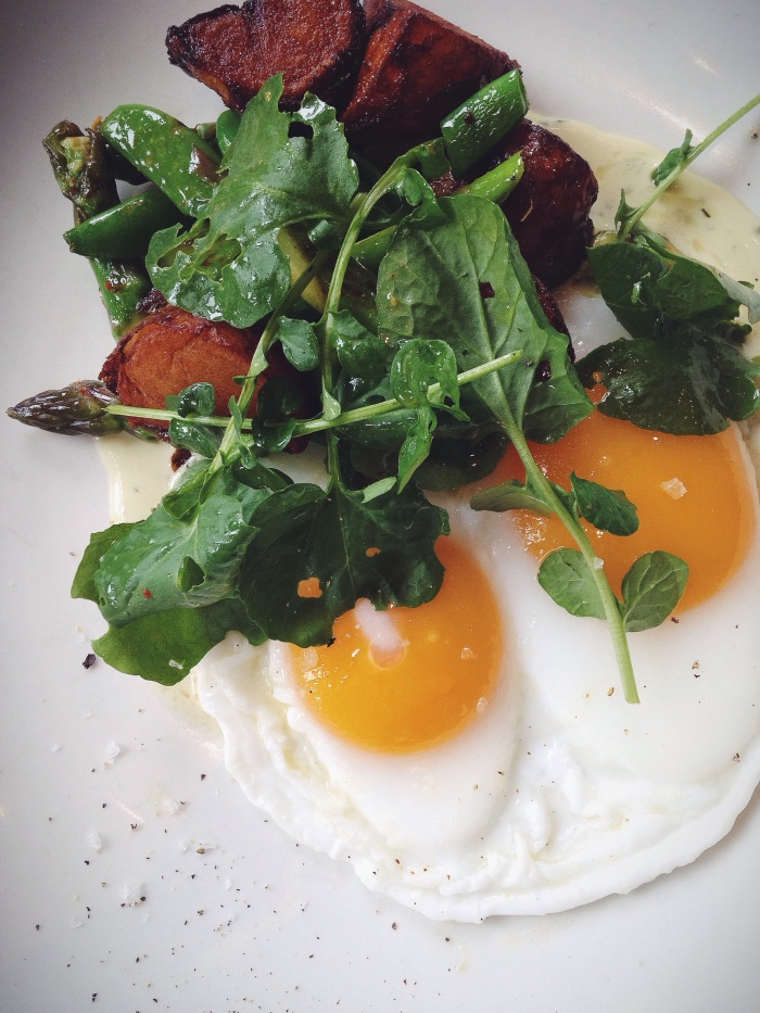 Butter Basted Duck Eggs  with Crispy Potatoes, Snap Peas, Asparagus and Sherry–Tarragon Cream