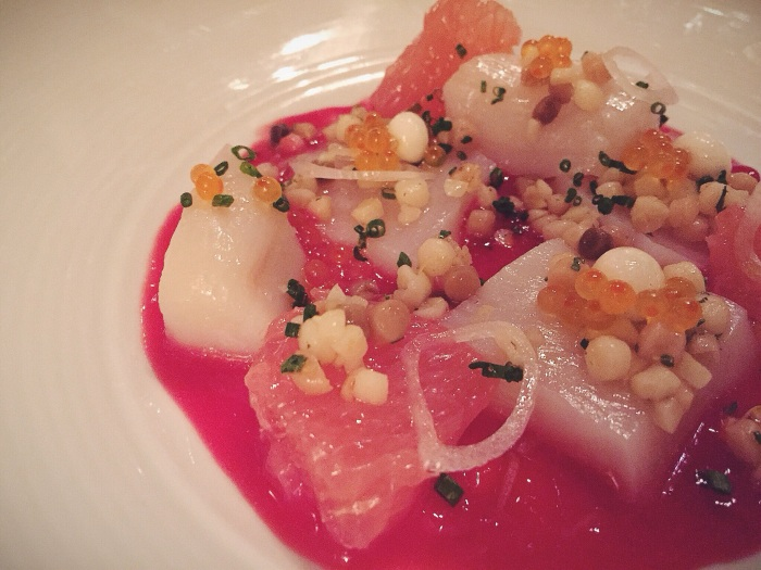 Scallop crudo with fregula, citrus, and smoked trout roe