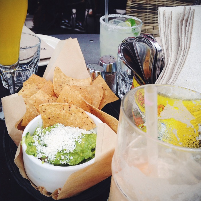 Drinks and guac...pitchers of margs are totally the way to go!