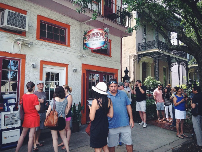 Sunday morning brunch crowd with a touch of classic NOLA architecture in the back
