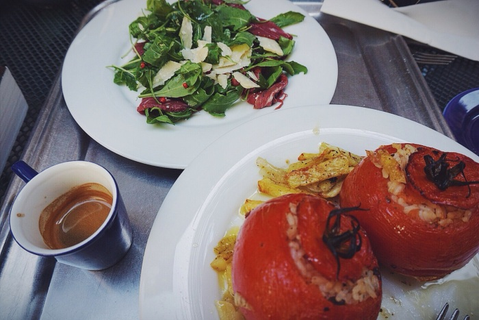 A delicious courtyard lunch of stuffed tomatoes and carpaccio