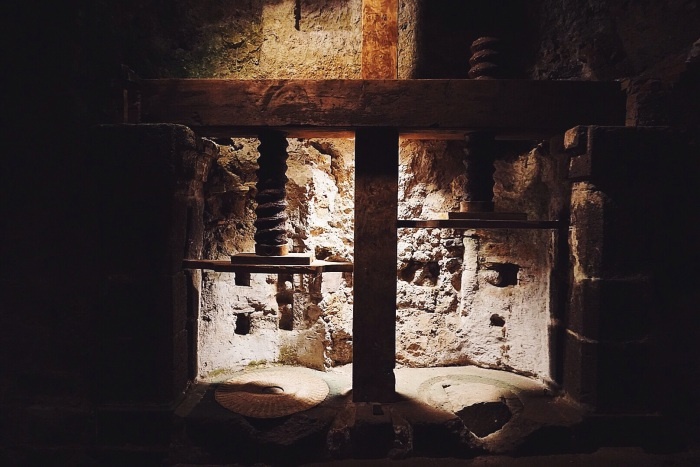 Underground olive oil press used by the original townspeople